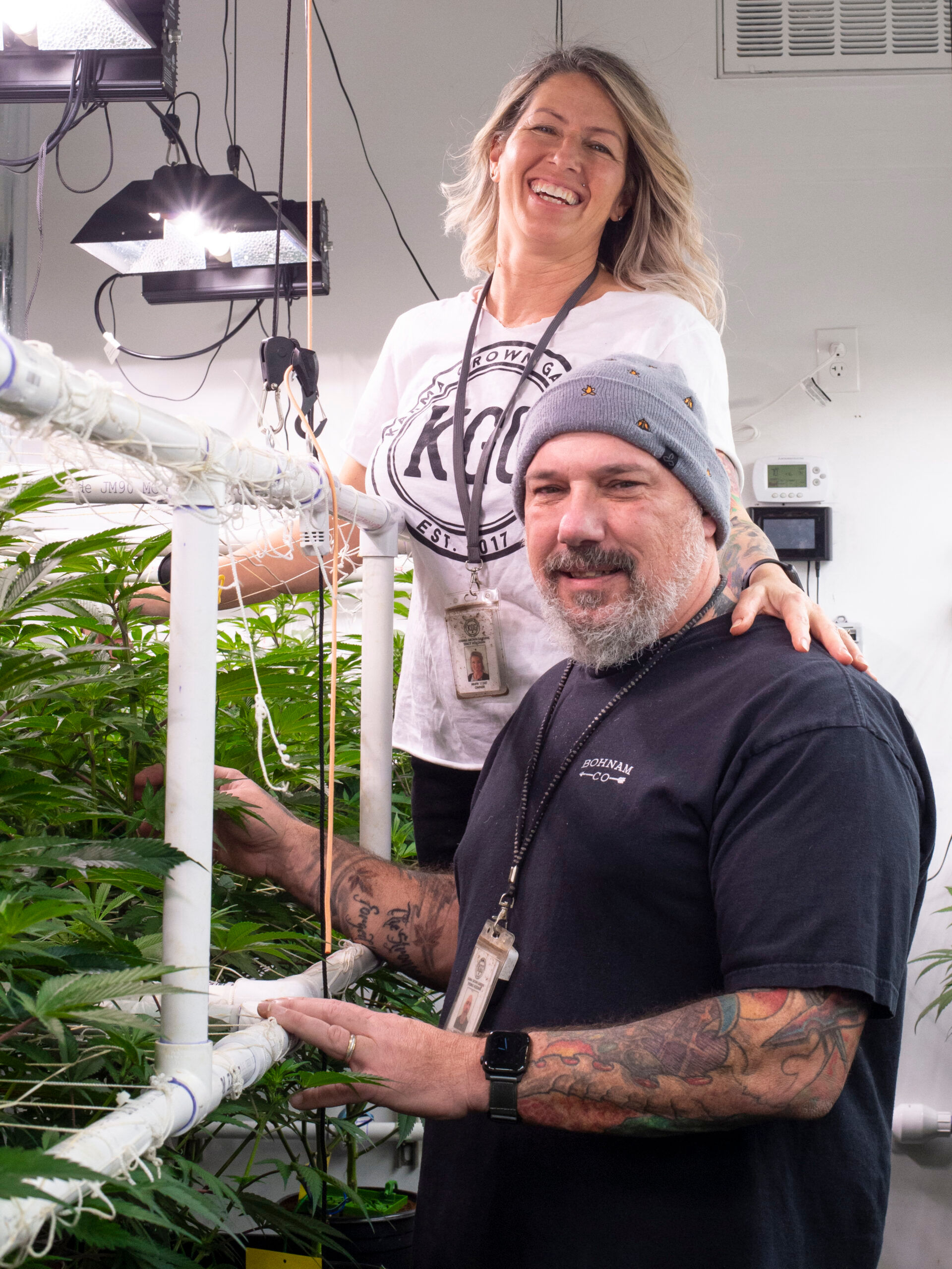 Karma Grown Gardens owners Tom and Stacy Holohan tend to their plants.