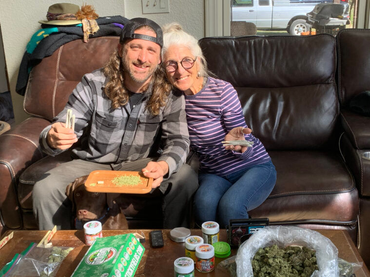 Jesse Robertson of Sticky Fields shares a joint with his mother.